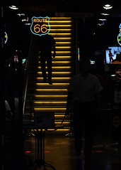 Get Your Kicks on Route 66 (mkorolkov) Tags: street streetphotography stripes yellow silhouette dark stairs bar fujifilm xe1 xc50230