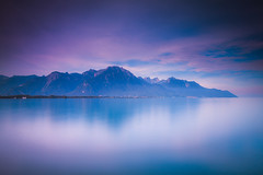 The Floating Mountains (Maximecreative) Tags: select landscape lake mountains water reflection clouds cloudscape summer calm horizon peaceful long exposure alps montreux serene alpes zen early morning atmospheric quiet scenic tranquility chateau de chillon montagnes lakefront french switzerland leman veytauxchillon