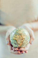 We don't own the world (| Les Hirondelles |) Tags: world life africa travel light sea white travelling ecology girl closeup canon globe holding hands message bright earth feminine pastel live maps fingers fromabove pale planet environment softfocus drawn fullframe nailpolish alis brightness youngwoman freshness storytelling humankind frash beautifulhands holdinhhands toyglobe littleglobe 5dmarkii wedontowntheworld