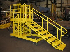 Mobile articulating access ladder