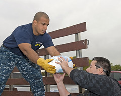 A Sailor unloads a donated turkey. (Official U.S. Navy Imagery) Tags: usa heritage america liberty freedom commerce unitedstates sandiego military navy sailors fast calif worldwide tradition usnavy protect deployed flexible onwatch beready defendfreedom warfighters nmcs chinfo sealanes warfighting preservepeace deteraggression operateforward warfightingfirst navymediacontentservice