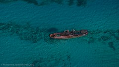 ghost ship (Mohamed.Abdelwahab) Tags: travel blue sky sun inspiration seascape green art industry beach nature water rock skyline skyscraper landscape boats outdoors island photography boat industrial day natural turquoise space aircraft air redsea egypt deep wave aerialview aerial photograph editorial coastline watersedge far advanced petroleum misr colorimage highangleview physicalgeography nauticalvessel elamal