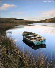 Reservoir Togs (SwaloPhoto) Tags: trees water grass reflections scotland boat shadows reservoir shore bog leefilters canoneos5dmkii stuartlow canontse24f35lii