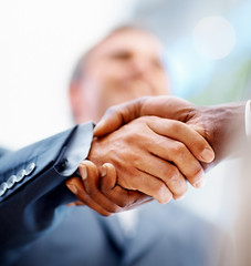 Closeup: Business men shaking hands over a deal (KOM Eventos) Tags: friends people man blur male men guy up sign businessman closeup denmark person office team hand close friendship adult finger background space united unity union meeting blurred professional business human together unite deal shake handshake contract concept copyspace success copy greeting partnership partner bonding partners cooperation pact businesspeople satisfied agreement congratulating