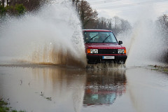 Parting of the water (Jamarem) Tags: november autumn red reflection water car rain weather river 4x4 flood leicestershire spray raining rangerover soar 2012 week48 18200mm canon50d view52 jamarem