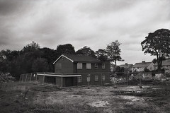Housing Estate Dereliction (Saturated Imagery) Tags: urban blackandwhite iso100 bradford derelict housingestate selfdeveloped luckyshd100 vivitar28mmf25 prakticatl5b rolleid74