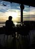 counting airplanes (julioc.) Tags: sunset people woman portugal water glass silhouette writing plane airplane faro bottle glow olympus transportation photowalk algarve oneperson e510 hardlight nonblog julioc challengeyouwinner olympuse510 ossonoba nonip scottkelbyworldwidephotowalk scottkelbyphotowalk j1024 scottkelbyworldwidephotowalk2012
