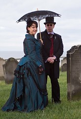 7D0046 Lady in Petrol Blue Dress with Black Parasol - Man in morning suit with top hat - Whitby Goth Weekend 3rd Nov 2012 (gemini2546) Tags: nov blue walking goth week 3rd black 2470 canon sigma dress suit walking top 7d lens church cane yard hat morning wine stick parasol whitby petrol 2012 lady man graves bussel wastcoat