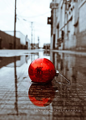 South Tacoma Christmas () Tags: christmas city red urban usa holiday color reflection water rain weather pen grit puddle photo washington alley seasons state image artistic spirit district south united decoration picture olympus gritty historic neighborhood ornament rainy photograph alleyway local tacoma states greetings yuletide selective sweetselectivecolor