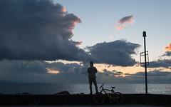 (γαηηιςκ) Tags: blue sunset orange lake man bike yellow clouds standing dark switzerland nikon ominous lac lausanne dslr leman epic ouchy d3000