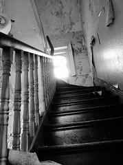In to the Light? (Compactman) Tags: shadow urban blackandwhite sunlight building abandoned architecture buildings lumix hall kent stair peeling angle decay dramatic hallway panasonic step bleak derelict rodchenko fz100 lillesden