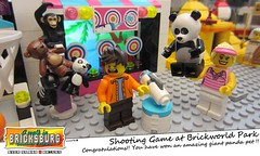 Shooting Game at Brickworld Park (EVWEB) Tags: lego minifigures amusement park brickworld bricksburg shooting targets game jungle wild animals monkey ape panda bear win won winner water 41127 friends