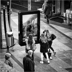 Greetings from Rotterdam (John Riper) Tags: johnriper street photography straatfotografie square vierkant bw black white zwartwit mono monochrome netherlands candid john riper canon 6d 24105 l rotterdam happy koopgoot beurstraverse beursplein young ladies school girls selfie screen amazed surprised watching