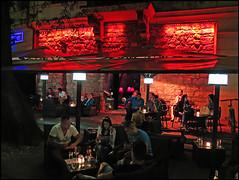 """Club Life"" - Lubljana, Slovenia (TravelsWithDan) Tags: club outdoors city urban nightclub seated colors red lubljana slovenia night candid"