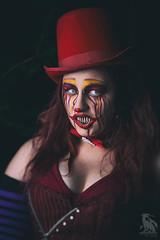 Portrait of a Clown (CJ Schmit) Tags: wwwcjschmitcom 5dmarkiii canon canon5dmarkiii cjschmit cjschmitphotography canonef85mmf18usm photographermilwaukee milwaukeephotographer photographerwisconsin dragonspitstudios clown amberrobinson female model woman teeth corset tophat gloves dark evil evilclown red whiteeyes scarry frightening helloween halloween forest hawthornglen milwaukeecountyparks park bowtie alienbeeb800 fotodioxprostudio60 octo softboxpocket wizards milwaukee wisconsin