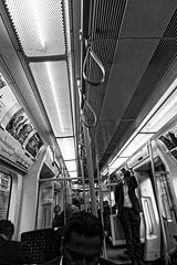 The Tube (Simply Lewis) Tags: canonpowershotg9x mono monochrome london underground transport commuting straps poles handles londonunderground tube