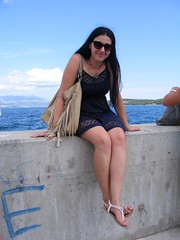 Nina... waiting for her boat to come in.... Harbour at Slatine, Ciovo Croatia (seanfderry-studenna) Tags: nina sitting seated wall harbour concrete grafitti slatine ciovo island croatia croatian serb adriatic coast europe european eu water sea ocean handbag sun sunglasses summer august 2016 woman female girl lady girlfriend fiancee wife happy smile smiling long dark hair brunette little blue dress skin tan tanned legs feet toes sandals arms shoulders pink lips mouth throat neck necklace sky clouds ankles hands pose posed posing beauty beautiful gorgeous stunning cute charm charming balkans