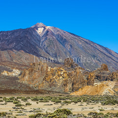 At the foot of the Teide volcano (Ivanov Andrey) Tags: mountain volcano hill lava slope valley desert rocks sky clouds horizon stone sand island plant flower bush grass yellow sulfurblack sun noon blue landscape perspective path road ascent descent shadow mountainrange mountainpeak nature travel tourism spain canaryislands tenerife teide