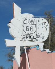 I have to wonder what this sign first represented (jimsawthat) Tags: metalsign arrow repurposedsign vintagesign hairsalon barbershop smalltown ashfork arizona route66