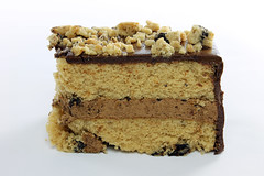 Chocolate Chunk Yellow Cake with Chocolate Frosting Closeup (donmarvin) Tags: food brown black macro cake closeup dessert dish sweet chocolate cream cook sugar gourmet delicious whitebackground eat slice bakery vegetarian pastry icing vanilla custard treat bake isolated baked mousse chocolatechip chocolatecake frosted fattening yellowcake chocolateicing chocolatefrosting chocolatechunk chocolatecream sliceofcake cakecrumb