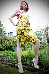 Catherine (Johnny Craig) Tags: female garden outdoor sunflowers vignette desperatehousewife