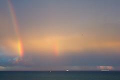 Rainbow (CruisAir) Tags: ocean sea sky water rain plane rainbow day ship aircraft jet double cruiseship doublerainbow