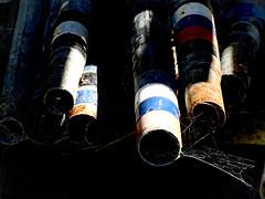 Forgotten Poles (Steve Taylor (Photography)) Tags: pole cobweb web farm black blue red metal plastic newzealand nz southisland canterbury bankspeninsula shadow sunny sunshine littleriver