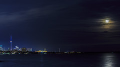 Toronto and Harvest moon (Greg David) Tags: marinaparade toronto ontario skyline torontoskyline nightphotography nightsky nightskyline canada lakeontario moon sky clouds water cn tower