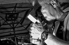 Fire it up. (Baz 120) Tags: candid candidstreet candidportrait city candidface candidphotography contrast colour street streetphoto streetcandid streetphotography streetphotograph streetportrait rome roma romepeople romecandid romestreets streetfaces monochrome monotone mono blackandwhite bw urban noiretblanc voigtlandercolorskopar21mmf40 life leicam8 leica primelens portrait people unposed italy italia grittystreetphotography flashstreetphotography faces flash decisivemoment strangers