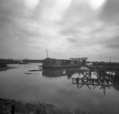 Arthur Kill boatyard (tastes like doggerel) Tags: nyc blackandwhite bw ny newyork abandoned mediumformat holga lomo lomography statenisland boatyard arthurkill holgasmic