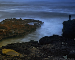 Contemplating the edge (Dave Arnold Photo) Tags: ocean longexposure sea usa man beach rock oregon centraloregon evening us photo moody pacific image or arnold shoreline picture peaceful wave pic formation photograph shore edge coastline oregoncoast geography geology centralcoast westcoast seashore ore tranquil loner yachats waterinmotion yahats davearnold wateredge centraloregoncoast davearnoldphotocom mygearandme