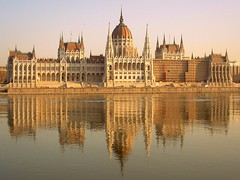 Budapest parliament mirrored on the Danube (German Vogel) Tags: city reflection building architecture river europe hungary politics capital budapest parliament dome government duna easteurope danube magyarorszag orszaghaz gothicrevivalstyle