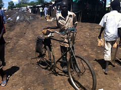 The Resilience and Dignity of Refugees in South Sudan (UNHCR) Tags: africa boy camp men bike bicycle child southsudan refugees bicycles help aid transportation protection assistance unhcr refugeecamp sudaneserefugees unrefugeeagency unitednationsrefugeeagency yusufbatil yusufbatilrefugeecamp psfrmission