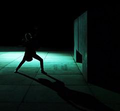 Winner Pose (CoolMcFlash) Tags: vienna wien street city light shadow woman green silhouette architecture female night pose dark square person photography austria licht sterreich fotografie nacht spot fav20 stadt cube architektur fujifilm format grn frau schatten wrfel dunkel nachtaufnahme fav10 nachtaufnahmen kontur umriss strase s100fs