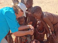 Sandi (USA) Showing Photos on iPad to Himba Children, Otjikandero Himba Village, Kunene, Namibia (dannymfoster) Tags: africa namibia otjikandero himbavillage otjikanderohimbavillage people africanpeople himba children himbachildren girl