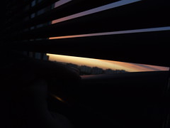 Sunset (Micsyy) Tags: sunset window city dark blinds