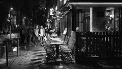 urban nocturnal chiaroscuro (lunaryuna) Tags: france lalsace strasbourg urban city urbannights citynights nightlife pub street people restaurant visitors chairsoutside nobodyssitting chiaroscuro blackwhite bw monochrome lunaryuna
