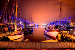 Sailing boats (piashdas) Tags: sea water sky boat reflection sail sailing travel night clouds harbour ocean summer urban boats port shore germany skyline europe bremerhaven cloud surf surfing longexposer dock harbor sailboat nightscape maritimes seaport watercraft