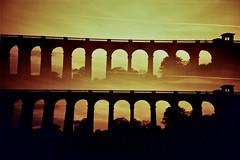 bridge of dreams (fotobes) Tags: silhouette lca dusk doubleexposure viaduct multipleexposure redscale balcombeviaduct ousevalleyviaduct splitzer lomographyredscale50200