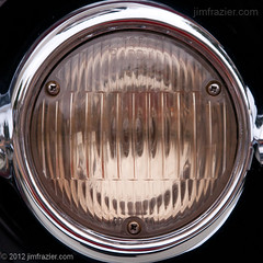 Headlight III (Jim Frazier (recovering - will be around more)) Tags: show street classic cars glass car silver square lens illinois highway shiny mechanical meetup geneva pov antique circles wheels august headlights symmetry il equipment machinery vehicles chrome transportation lincoln third squaredcircle symmetrical machines kanecounty kane perpendicular centered classiccars automobiles carshow q3 apparatus 2012 devices thirdstreet lincolnhighway rounds headon radials centralperspective wscf westsuburbanchicagoflickrers ldnovember ©jimfraziercom ld2012 wmembed
