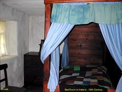 Irish Cottages.- Bedroom in Ireland, Donegal 19th Century. (mrvisk) Tags: old irish history capes poor content mrvisk pic linen wooden headboard patch work quilt hard times family home sleep 1870s bedside furniture co 4 poster bed