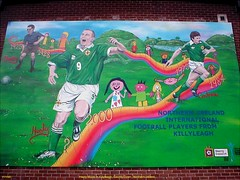 Northern Ireland.- David Healy MBE, Terry Cochrane n Hugh Davey, Mural in Killyleagh, County Down. (mrvisk) Tags: old irish history soccer art painting green white army ifa ulster goals wall stone brick emblem strip proud pride local heros village boots strips strikers goal scorers honour 1925 1975 2000 team spirit legends town co pic sport groupshot mrvisk people outdoor street linfield rangers