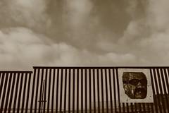 IMG_1993 (Jonathan Soch) Tags: ocean california las sky white man black beach monochrome face sign wall clouds canon fence mexico pacific border iso 100 baja tijuana playas t3i