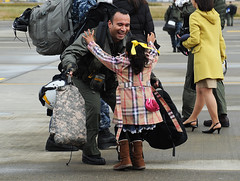An Sailor greets his daughter after returning home. (Official U.S. Navy Imagery) Tags: heritage japan america liberty freedom commerce unitedstates military navy sailors fast worldwide tradition usnavy protect deployed flexible onwatch beready defendfreedom warfighters nmcs chinfo sealanes warfighting navalairstationatsugi preservepeace deteraggression operateforward warfightingfirst navymediacontentservice