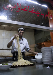 Cook Preparing Laghman, Yarkand, Xinjiang Uyghur Autonomous Region, China (Eric Lafforgue) Tags: china travel people man tourism cooking vertical person restaurant persian uniform day nightshot eating muslim chinese cook citylife plate indoor meat nightmarket pastry lamb uighur xinjiang silkroad customer daytime inside noodle nightscene nightlife nightview uyghur minority oldtown selling kebab foodanddrink turkish anthropology oneperson preparing baked gastronomy ethnicity onepeople sociology marketstall peoplesrepublicofchina autonomy dayview turkic humanright uygur preparingfood ouigour smallbusiness yarkand colorpicture 1people doppi ethnicgroup laghman img7594 colourpicture xinjianguyghurautonomousregion easternandcentralasia turkicethnicgroup doppilar