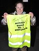 A fan displays a hi-vis bib signed by Michael Buble saying 'I want to be your kevin costner' oustide the Merrion Hotel Singer Michael Buble and his wife Luisana Lopilato leave Bang Restaurant.