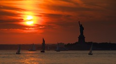 Lady Sunset (DPGold Photos) Tags: nyc sunset orange sun ny newyork reflection water silhouette statue brooklyn sailboat river boats cityscape whiskey statueofliberty redhook widowjane cacaoprieto