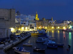 Monopoli old town (leocicosimo) Tags: longexposure blue red sea sky italy castle cars church colors yellow boats lights evening italia mare cathedral blu flag barche belltower chiesa campanile giallo cielo luci oldport oldtown rosso colori lungomare castello puglia sera adriatico automobili cattedrale bandiera centrostorico apulia monopoli portovecchio lungaesposizione