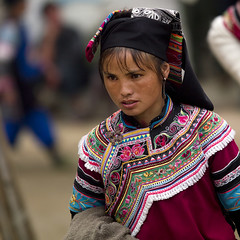 Woman During A Funeral Procession, Yuanyang, Yunnan Province, China (Eric Lafforgue) Tags: china portrait people color colour square outdoors person photography costume women asia day pattern adult market outdoor parade womenonly yunnan custom multicolored adultsonly oneperson hani traditionaldress onepeople frontview traditionalculture yuanyang eastasia chineseculture traditionalclothing realpeople colorimage onewomanonly colorpicture yunnanprovince adultonly 1people indigenousculture focusonforeground a0006672