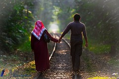 Taking the journey of life together (Mahran Fadlullah [www.thedreamcatchers.com.bd]) Tags: love couple holdinghands raillines lovetunnel journeyoflife aboyandagirl deepinlove coupleinaforest rainlinesinforest
